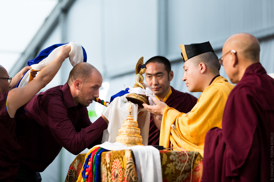 """symbolic offerings are made to the Karmapa: the mandala of the universe as well as the body, speech, mind, the qualities and the enlightened activity."""
